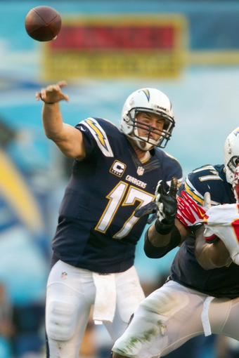 Dec 29, 2013; San Diego, CA, USA;  San Diego Chargers quarterback Philip Rivers (17) throws the ball in the 4th quarter during the Chargers 27-24 overtime win over the Kansas City Chiefs at Qualcomm Stadium. Mandatory Credit: Stan Liu-USA TODAY Sports