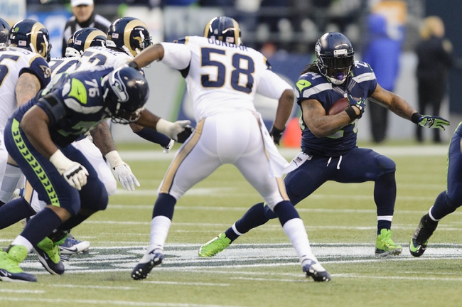 Dec 29, 2013; Seattle, WA, USA; Seattle Seahawks running back Marshawn Lynch (24) carries the ball against the St. Louis Rams during the second half at CenturyLink Field. Seattle won 27-9. Mandatory Credit: Steven Bisig-USA TODAY Sports