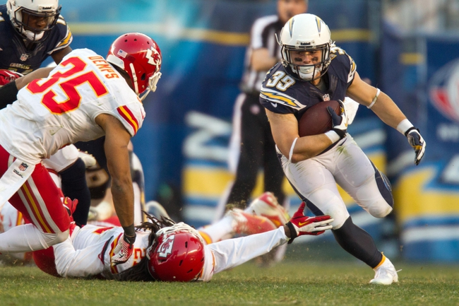 Dec 29, 2013; San Diego, CA, USA;  San Diego Chargers running back Danny Woodhead (39) carries the ball in overtime during the Chargers 27-24 overtime win over the Kansas City Chiefs at Qualcomm Stadium. Mandatory Credit: Stan Liu-USA TODAY Sports