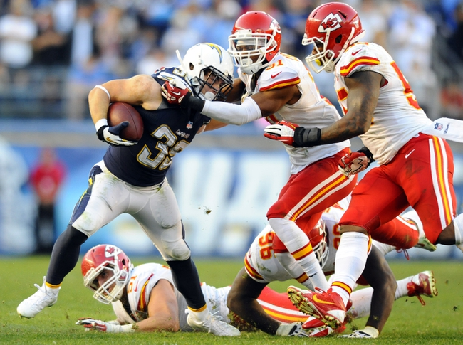 Dec 29, 2013; San Diego, CA, USA; San Diego Chargers running back Danny Woodhead (39) fights off a couple of Kansas City Chiefs defenders during the overtime period at Qualcomm Stadium. The Chargers won 27-24 in overtime. Mandatory Credit: Christopher Hanewinckel-USA TODAY Sports