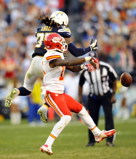 Dec 29, 2013; San Diego, CA, USA; San Diego Chargers defensive back Jahleel Addae (37) breaks up a pass for Kansas City Chiefs receiver A.J. Jenkins (15) on the Chiefs final possession in overtime at Qualcomm Stadium. The Chargers won 27-24 in overtime. Mandatory Credit: Christopher Hanewinckel-USA TODAY Sports