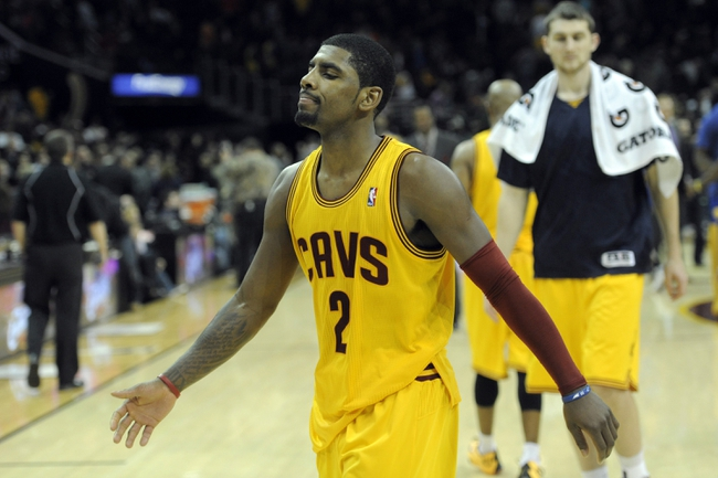 Dec 29, 2013; Cleveland, OH, USA; Cleveland Cavaliers point guard Kyrie Irving (2) walks off the court after a 108-104 overtime loss to the Golden State Warriors at Quicken Loans Arena. Mandatory Credit: David Richard-USA TODAY Sports