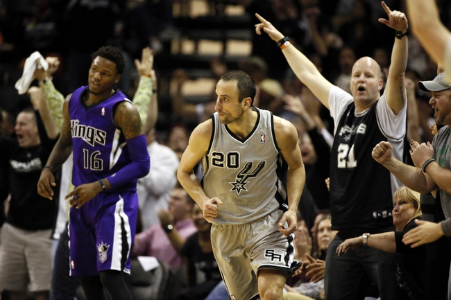 Dec 29, 2013; San Antonio, TX, USA; San Antonio Spurs guard Manu Ginobili (20) reacts after a shot during the second half against the Sacramento Kings at the AT&T Center. The Spurs won 112-104. Mandatory Credit: Soobum Im-USA TODAY Sports
