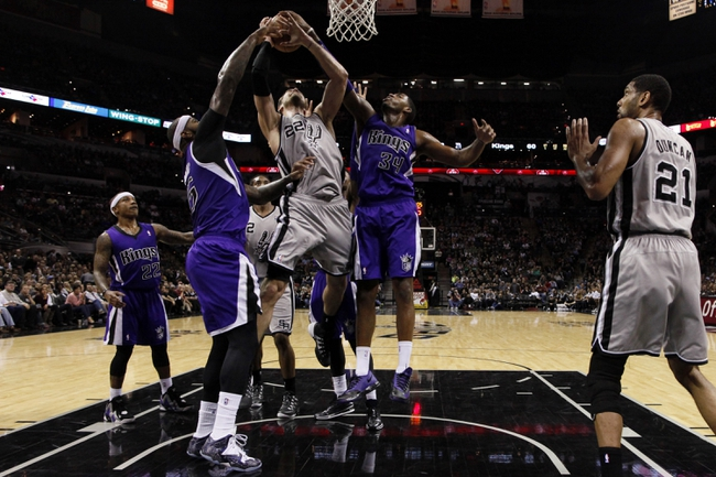 Dec 29, 2013; San Antonio, TX, USA; San Antonio Spurs forward Tiago Splitter (22) has his shot blocked by Sacramento Kings forward Jason Thompson (34) during the second half at the AT&T Center. The Spurs won 112-104. Mandatory Credit: Soobum Im-USA TODAY Sports