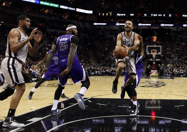 Dec 29, 2013; San Antonio, TX, USA; San Antonio Spurs guard Tony Parker (9) drives to the basket during the second half against the San Antonio Spurs at the AT&T Center. The Spurs won 112-104. Mandatory Credit: Soobum Im-USA TODAY Sports