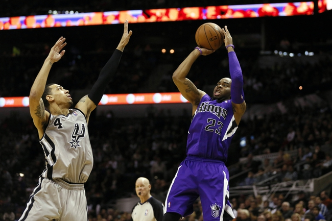Dec 29, 2013; San Antonio, TX, USA; Sacramento Kings guard Marcus Thornton (23) shoots against San Antonio Spurs guard Danny Green (4) during the second half at the AT&T Center. The Spurs won 112-104. Mandatory Credit: Soobum Im-USA TODAY Sports