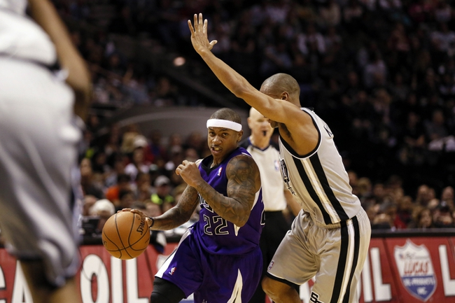Dec 29, 2013; San Antonio, TX, USA; Sacramento Kings guard Isaiah Thomas (22) drives against San Antonio Spurs guard Patrick Mills (right) during the second half at the AT&T Center. The Spurs won 112-104. Mandatory Credit: Soobum Im-USA TODAY Sports