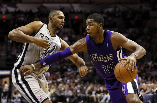 Dec 29, 2013; San Antonio, TX, USA; Sacramento Kings forward Jason Thompson (34) drives to the basket while guarded by San Antonio Spurs forward Boris Diaw (33) during the second half at the AT&T Center. The Spurs won 112-104. Mandatory Credit: Soobum Im-USA TODAY Sports