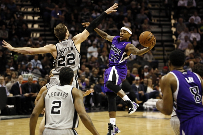 Dec 29, 2013; San Antonio, TX, USA; Sacramento Kings guard Isaiah Thomas (22) passes around San Antonio Spurs forward Tiago Splitter (22) during the second half at the AT&T Center. The Spurs won 112-104. Mandatory Credit: Soobum Im-USA TODAY Sports