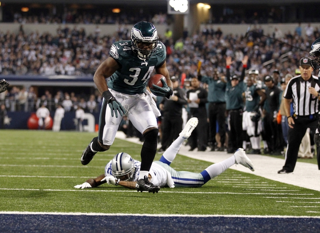 Dec 29, 2013; Arlington, TX, USA; Philadelphia Eagles running back Bryce Brown (34) scores a touchdown as Dallas Cowboys cornerback Orlando Scandrick (32) defends in the fourth quarter at AT&T Stadium. Mandatory Credit: Tim Heitman-USA TODAY Sports