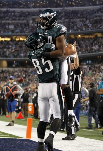 Dec 29, 2013; Arlington, TX, USA; Philadelphia Eagles running back Bryce Brown (34) celebrates a touchdown with tight end James Casey (85) in the fourth quarter against the Dallas Cowboys at AT&T Stadium. Mandatory Credit: Tim Heitman-USA TODAY Sports
