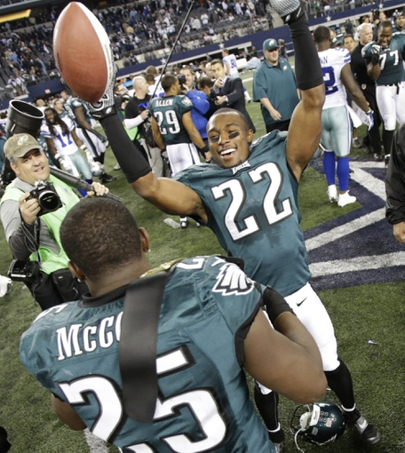 Dec 29, 2013; Arlington, TX, USA; Philadelphia Eagles cornerback Brandon Boykin (22) celebrates with running back LeSean McCoy (25) after the game against the Dallas Cowboys at AT&T Stadium. The Eagle beat the Cowboys 24-22. Mandatory Credit: Tim Heitman-USA TODAY Sports