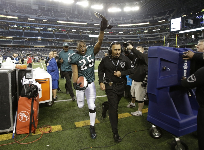 Dec 29, 2013; Arlington, TX, USA; Philadelphia Eagles running back LeSean McCoy (25) celebrates while he leaves the field after the game against the Dallas Cowboys at AT&T Stadium. The Eagle beat the Cowboys 24-22. Mandatory Credit: Tim Heitman-USA TODAY Sports