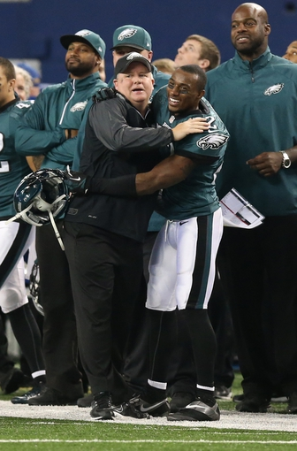 Dec 29, 2013; Arlington, TX, USA; Philadelphia Eagles cornerback Brandon Boykin (22) celebrates with head coach Chip Kelly late in the fourth quarter against the Dallas Cowboys at AT&T Stadium. The Eagle beat the Cowboys 24-22. Mandatory Credit: Matthew Emmons-USA TODAY Sports