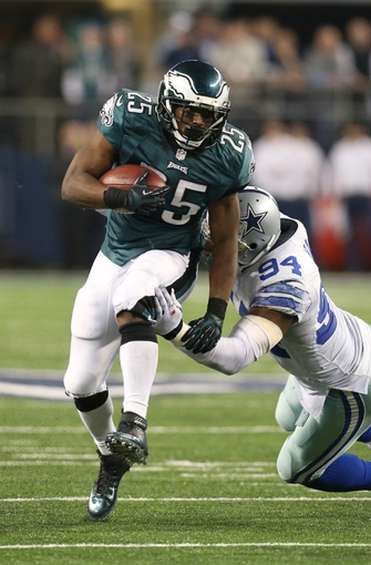 Dec 29, 2013; Arlington, TX, USA; Philadelphia Eagles running back LeSean McCoy (25) runs with the ball against Dallas Cowboys defensive end DeMarcus ware (94) in the fourth quarter at AT&T Stadium. The Eagle beat the Cowboys 24-22. Mandatory Credit: Matthew Emmons-USA TODAY Sports