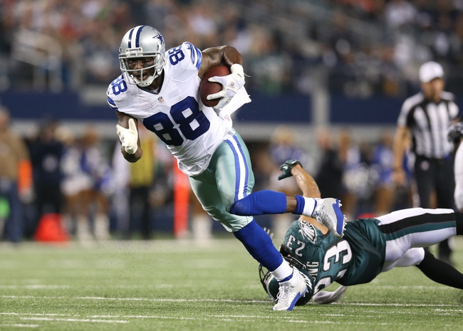 Dec 29, 2013; Arlington, TX, USA; Dallas Cowboys receiver Dez Bryant (88) runs after a reception for a fourth quarter touchdown against Philadelphia Eagles safety Patrick Chung (23) at AT&T Stadium. The Eagle beat the Cowboys 24-22. Mandatory Credit: Matthew Emmons-USA TODAY Sports