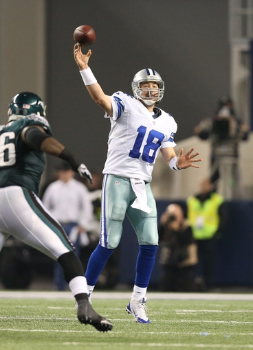 Dec 29, 2013; Arlington, TX, USA; Dallas Cowboys quarterback Kyle Orton (18) throws under pressure from Philadelphia Eagles nose tackle Bennie Logan (96) in the fourth quarter at AT&T Stadium. Mandatory Credit: Matthew Emmons-USA TODAY Sports