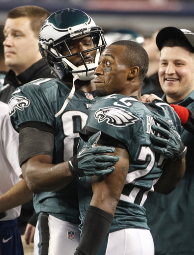 Dec 29, 2013; Arlington, TX, USA; Philadelphia Eagles wide receiver Jason Avant (81) and cornerback Brandon Boykin (22) celebrate on the sidelines in the fourth quarter of the game against the Dallas Cowboys at AT&T Stadium. The Eagle beat the Cowboys 24-22. Mandatory Credit: Tim Heitman-USA TODAY Sports