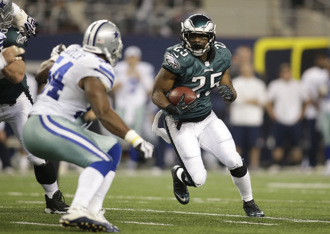 Dec 29, 2013; Arlington, TX, USA; Philadelphia Eagles running back LeSean McCoy (25) runs the ball in the fourth quarter against the Dallas Cowboys at AT&T Stadium. The Eagle beat the Cowboys 24-22. Mandatory Credit: Tim Heitman-USA TODAY Sports