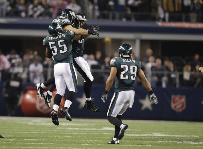 Dec 29, 2013; Arlington, TX, USA; Philadelphia Eagles outside linebacker Connor Barwin (98) and outside linebacker Casey Matthews (50) and linebacker Brandon Graham (55) and strong safety Nate Allen (29) celebrate knocking down a fourth down pass in the fourth quarter against the Dallas Cowboys at AT&T Stadium. The Eagle beat the Cowboys 24-22. Mandatory Credit: Tim Heitman-USA TODAY Sports