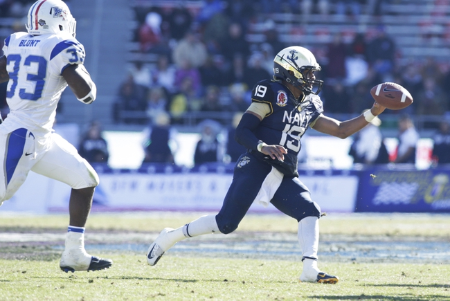 Dec 30, 2013; Fort Worth, TX, USA; Navy Midshipmen quarterback Keenan Reynolds (19) pitches the ball in the second quarter against the Middle Tennessee Blue Raiders  at Amon G. Carter Stadium. Mandatory Credit: Tim Heitman-USA TODAY Sports