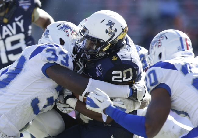 Dec 30, 2013; Fort Worth, TX, USA; Middle Tennessee Blue Raiders linebacker Roderic Blunt (33) tackles Navy Midshipmen running back Darius Staten (20) in the second quarter of the game at Amon G. Carter Stadium. Mandatory Credit: Tim Heitman-USA TODAY Sports