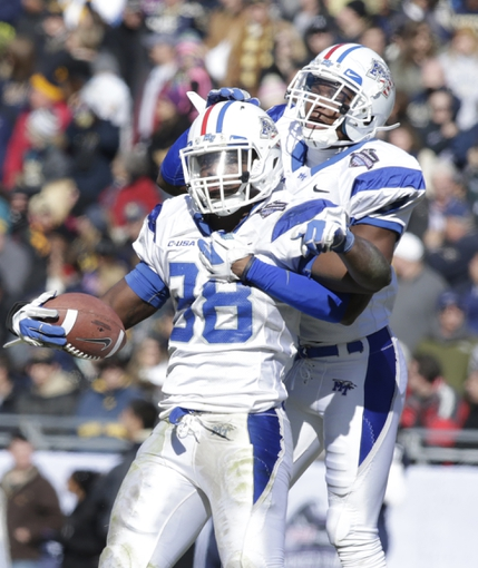 Dec 30, 2013; Fort Worth, TX, USA; Middle Tennessee Blue Raiders linebacker T.T. Barber (38) and a teammate celebrate a fumble recovery in the third quarter of the game  at Amon G. Carter Stadium. Mandatory Credit: Tim Heitman-USA TODAY Sports