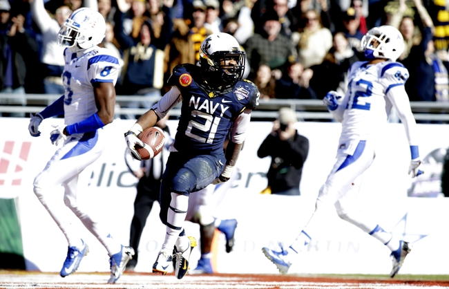 Dec 30, 2013; Fort Worth, TX, USA;  Navy Midshipmen running back DeBrandon Sanders (21) runs for a touchdown in the fourth quarter of the game against the Middle Tennessee Blue Raiders at Amon G. Carter Stadium. Mandatory Credit: Tim Heitman-USA TODAY Sports