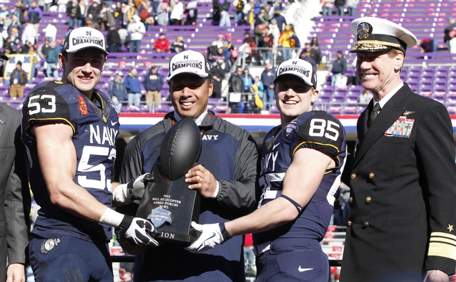 Dec 30, 2013; Fort Worth, TX, USA;  (L to R) Navy Midshipmen linebacker Cody Peterson (53) head coach Kenneth Niumatalolo wide receiver Matt Aiken (85) and superintendent Michael Miller hold the trophy after the game against the Middle Tennessee Blue Raiders at Amon G. Carter Stadium. Navy beat Middle Tennessee 24-6. Mandatory Credit: Tim Heitman-USA TODAY Sports