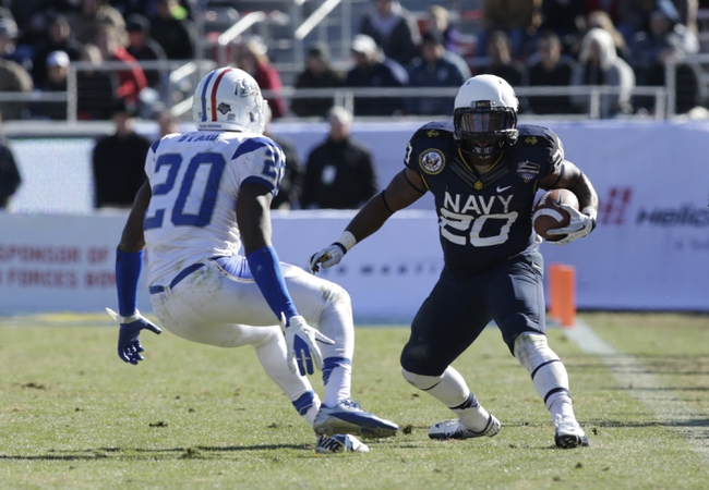 Dec 30, 2013; Fort Worth, TX, USA; Navy Midshipmen running back Darius Staten (20) runs the ball against Middle Tennessee Blue Raiders safety Kevin Byard (20) in the game  at Amon G. Carter Stadium.  Navy beat Middle Tennessee 24-6. Mandatory Credit: Tim Heitman-USA TODAY Sports