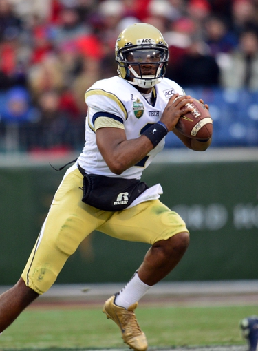 Dec 30, 2013; Nashville, TN, USA; Georgia Tech Yellow Jackets quarterback Vad Lee (2) scrambles from the pocket against the Mississippi Rebels during the first half at LP Field. The Rebels beat the Yellow Jackets 25-17. Mandatory Credit: Don McPeak-USA TODAY Sports