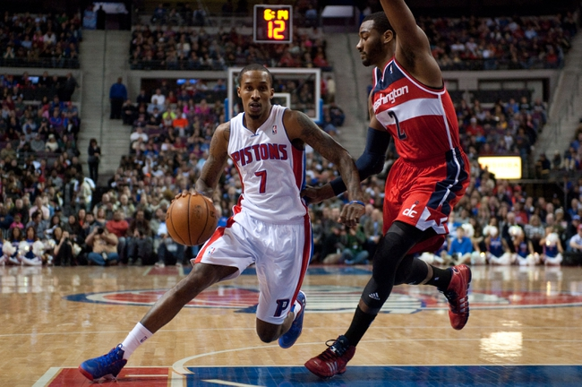 Dec 30, 2013; Auburn Hills, MI, USA; Detroit Pistons point guard Brandon Jennings (7) drives to the basket against Washington Wizards point guard John Wall (2) during the second quarter at The Palace of Auburn Hills. Mandatory Credit: Tim Fuller-USA TODAY Sports