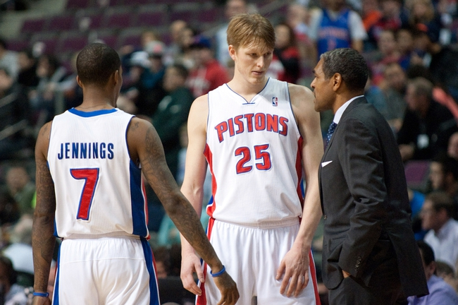Dec 30, 2013; Auburn Hills, MI, USA; Detroit Pistons head coach Maurice Cheeks talks to small forward Kyle Singler (25) and point guard Brandon Jennings (7) during the fourth quarter against the Washington Wizards at The Palace of Auburn Hills. Washington won 106-99. Mandatory Credit: Tim Fuller-USA TODAY Sports