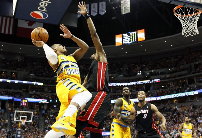 Dec 30, 2013; Denver, CO, USA; Denver Nuggets point guard Randy Foye (4) takes a shot against Miami Heat center Chris Bosh (1) in the second quarter at the Pepsi Center. Mandatory Credit: Isaiah J. Downing-USA TODAY Sports