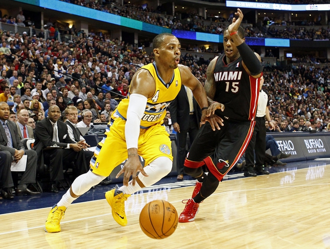 Dec 30, 2013; Denver, CO, USA; Denver Nuggets point guard Randy Foye (4) drives to the net against Miami Heat point guard Mario Chalmers (15) in the second quarter at the Pepsi Center. Mandatory Credit: Isaiah J. Downing-USA TODAY Sports