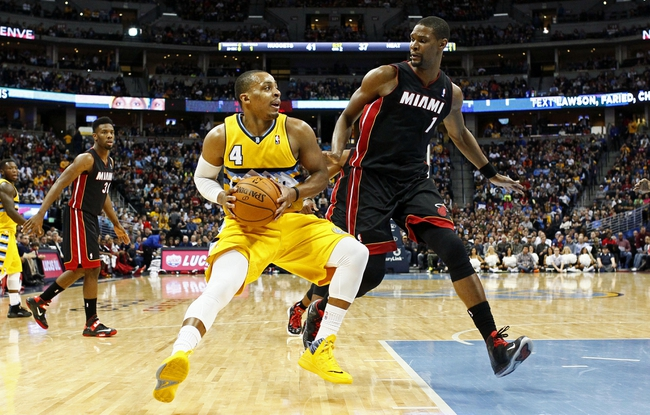 Dec 30, 2013; Denver, CO, USA; Miami Heat center Chris Bosh (1) guards Denver Nuggets point guard Randy Foye (4) in the second quarter at the Pepsi Center. Mandatory Credit: Isaiah J. Downing-USA TODAY Sports