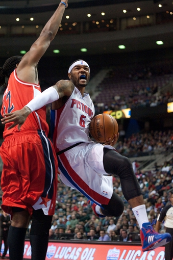 Dec 30, 2013; Auburn Hills, MI, USA; Detroit Pistons small forward Josh Smith (6) goes to the basket against Washington Wizards power forward Nene Hilario (42) during the first quarter at The Palace of Auburn Hills. Mandatory Credit: Tim Fuller-USA TODAY Sports