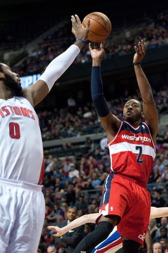 Dec 30, 2013; Auburn Hills, MI, USA; Washington Wizards point guard John Wall (2) shoots during the fourth quarter against the Detroit Pistons at The Palace of Auburn Hills. Washington won 106-99. Mandatory Credit: Tim Fuller-USA TODAY Sports
