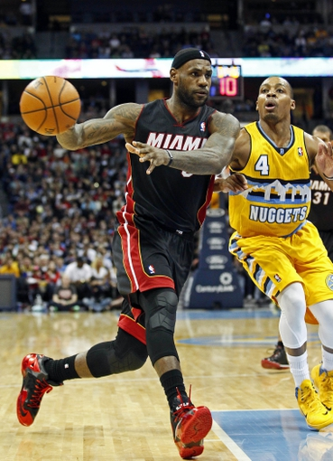 Dec 30, 2013; Denver, CO, USA; Miami Heat small forward LeBron James (6) keeps the ball from Denver Nuggets point guard Randy Foye (4) in the third quarter at the Pepsi Center. The Heat defeated the Nuggets 97-94. Mandatory Credit: Isaiah J. Downing-USA TODAY Sports