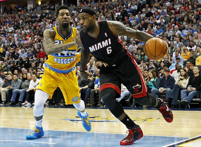 Dec 30, 2013; Denver, CO, USA; Miami Heat small forward LeBron James (6) dribbles the ball past Denver Nuggets shooting guard Wilson Chandler (21) in the third quarter at the Pepsi Center. The Heat defeated the Nuggets 97-94. Mandatory Credit: Isaiah J. Downing-USA TODAY Sports