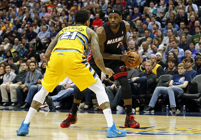 Dec 30, 2013; Denver, CO, USA; Denver Nuggets shooting guard Wilson Chandler (21) guards Miami Heat small forward LeBron James (6) in the third quarter at the Pepsi Center. The Heat defeated the Nuggets 97-94. Mandatory Credit: Isaiah J. Downing-USA TODAY Sports