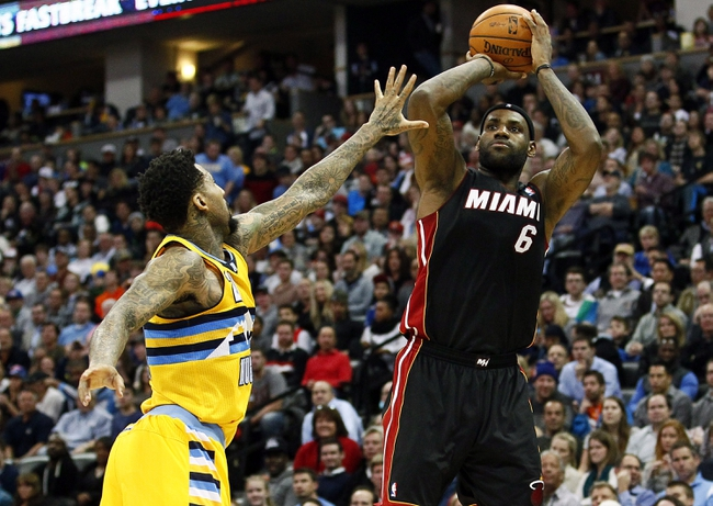 Dec 30, 2013; Denver, CO, USA; Miami Heat small forward LeBron James (6) takes a shot against Denver Nuggets shooting guard Wilson Chandler (21) in the third quarter at the Pepsi Center. The Heat defeated the Nuggets 97-94. Mandatory Credit: Isaiah J. Downing-USA TODAY Sports