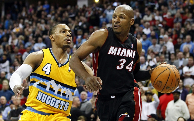 Dec 30, 2013; Denver, CO, USA; Denver Nuggets point guard Randy Foye (4) defends against Miami Heat shooting guard Ray Allen (34) in the fourth quarter at the Pepsi Center. The Heat defeated the Nuggets 97-94. Mandatory Credit: Isaiah J. Downing-USA TODAY Sports