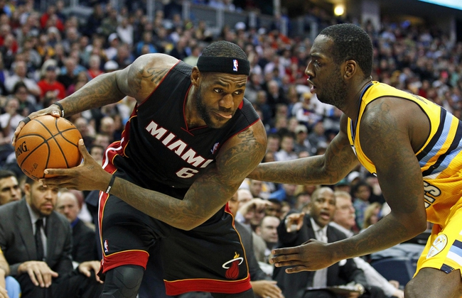 Dec 30, 2013; Denver, CO, USA; Denver Nuggets power forward J.J. Hickson (7) guards Miami Heat small forward LeBron James (6) in the fourth quarter at the Pepsi Center. The Heat defeated the Nuggets 97-94. Mandatory Credit: Isaiah J. Downing-USA TODAY Sports