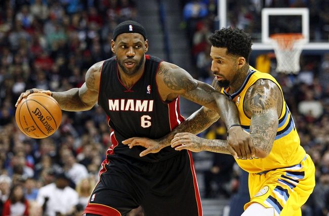Dec 30, 2013; Denver, CO, USA; Miami Heat small forward LeBron James (6) keeps the ball from Denver Nuggets shooting guard Wilson Chandler (21) in the fourth quarter at the Pepsi Center. The Heat defeated the Nuggets 97-94. Mandatory Credit: Isaiah J. Downing-USA TODAY Sports
