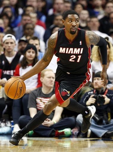 Dec 30, 2013; Denver, CO, USA;Miami Heat shooting guard Roger Mason Jr. (21) dribbles the ball in the fourth quarter against the Denver Nuggets at the Pepsi Center. The Heat defeated the Nuggets 97-94. Mandatory Credit: Isaiah J. Downing-USA TODAY Sports