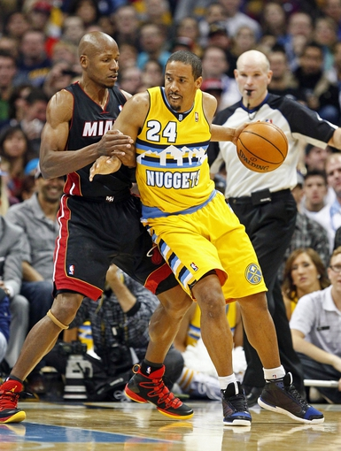 Dec 30, 2013; Denver, CO, USA; Miami Heat shooting guard Ray Allen (34) guards Denver Nuggets point guard Andre Miller (24) in the fourth quarter at the Pepsi Center. The Heat defeated the Nuggets 97-94. Mandatory Credit: Isaiah J. Downing-USA TODAY Sports
