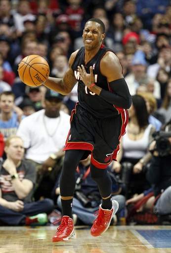 Dec 30, 2013; Denver, CO, USA; Miami Heat point guard Mario Chalmers (15) reacts after a play in the fourth quarter against the Denver Nuggets at the Pepsi Center. The Heat defeated the Nuggets 97-94. Mandatory Credit: Isaiah J. Downing-USA TODAY Sports