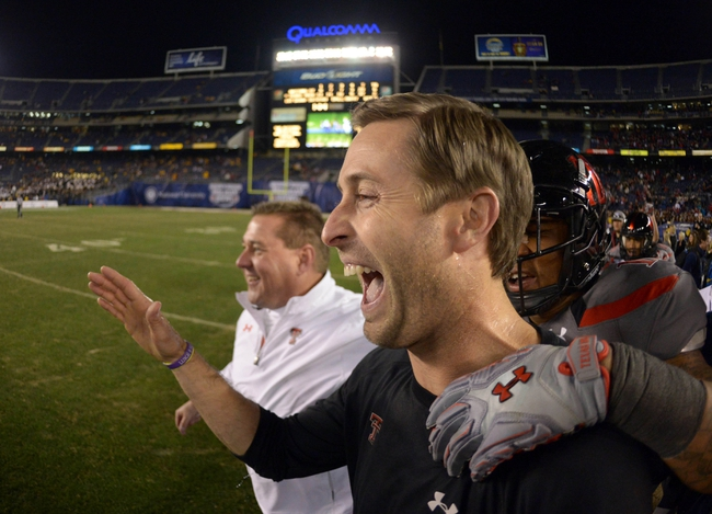 Dec 30, 2013; San Diego, CA, USA; Texas Tech Red Raiders coach Kliff Kingsbury celebrates at the end of the 2013 Holiday Bowl against the Arizona State Sun Devils at Qualcomm Stadium. Texas Tech defeated Arizona State 37-23. Mandatory Credit: Kirby Lee-USA TODAY Sports