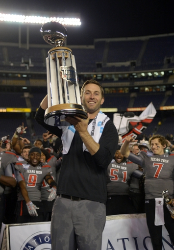 Dec 30, 2013; San Diego, CA, USA; Texas Tech Red Raiders coach Kliff Kingsbury poses with the championship trophy after the 2013 Holiday Bowl against the Arizona State Sun Devils at Qualcomm Stadium. Texas Tech defeated Arizona State 37-23. Mandatory Credit: Kirby Lee-USA TODAY Sports